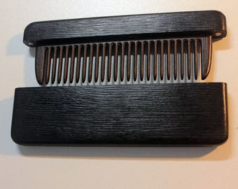 Comb in a case of black hornbeam