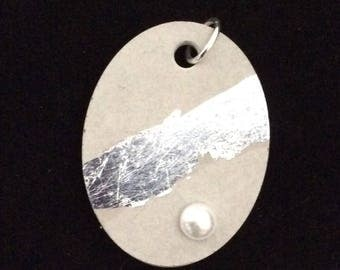 Pendant in concrete, oval, with silver leaf and pearl
