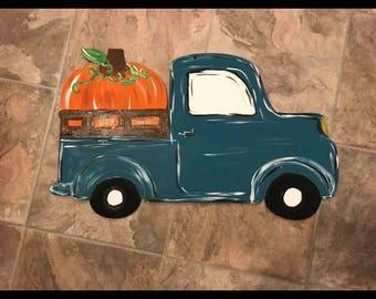 Vintage Truck Carrying a Pumpkin