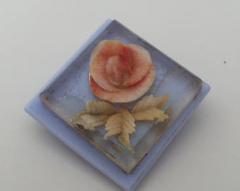 Vintage 1960's sky blue resin brooch with peachy-coloured flower in the middle