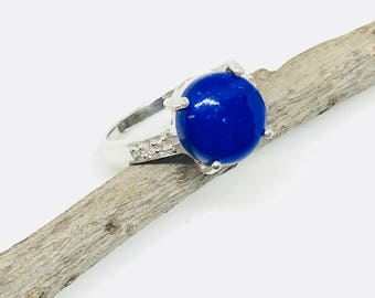 Lapis lazuli and white topaz  ring set in Sterling silver 925. Size- 8 1/2. Natural authentic lapis stone- 12mm round.