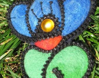 large blue flower brooch in felting wool.