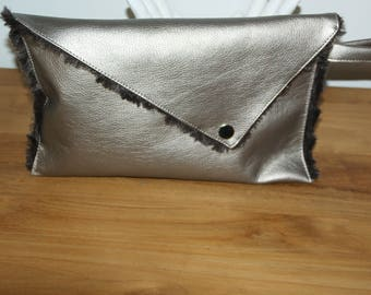 Cover has asymmetrical flap in faux leather and faux fur.