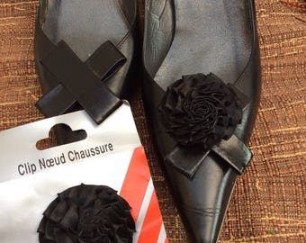 a pair of black satin flower shoe Clips