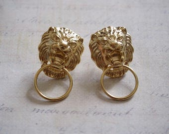 2 support nails lion and 32x20mm light golden metal ring