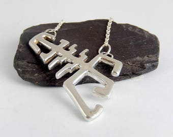 """Solid sterling silver pendant with 16"""" chain attached"""