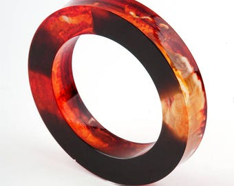 Bulky resin bangle, black and orange, diamater 2,51 in / 6,4 cm