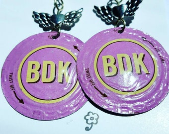 Pink upcycled Brew Dr Kombucha Bottle-cap earrings.