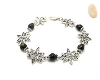 Silver bracelet black and gold flower and pearls.