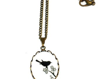 Necklace bronzes cabochon black Bird on branch