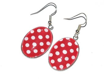 Earrings oval dots on red background