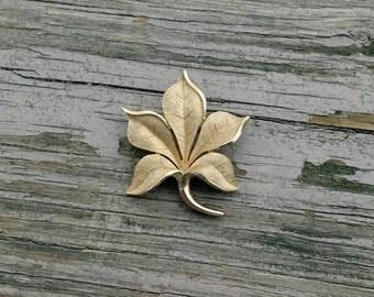 Vintage Crown Trifari gold leaf brooch