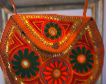 Small leather bag with embroidery and sequins
