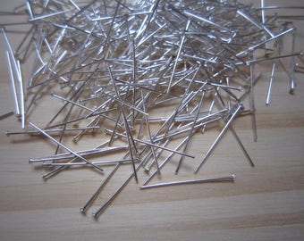 Set of posts or silver metal studs