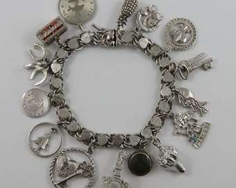 """7"""" Sterling Silver Charm Bracelet With 15 Vintage Charms"""