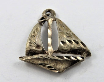 Sailboat with Pattern Sails Sterling Silver Charm or Pendant.