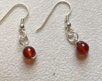 Dainty sterling silver dangle earring with gem bead.