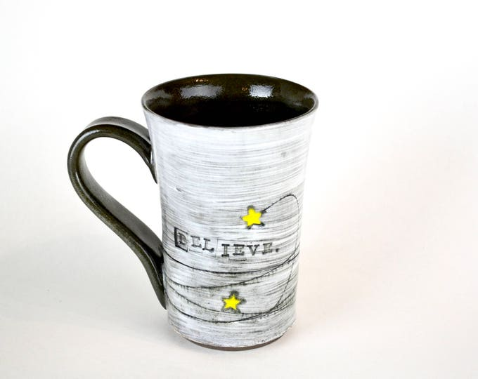 "Handmade pottery mug with stars ""Believe"""