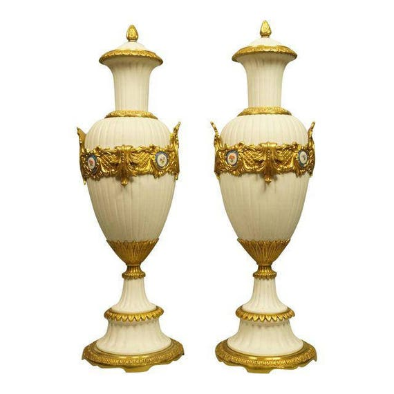 Antique pair of porcelain bisque Urns.