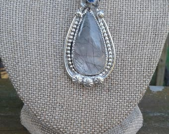 Tear drop shaped Rutilated Quartz stone in Sterling silver setting with chain