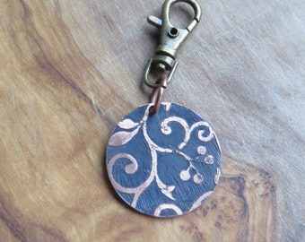 etched copper disc in floral motif