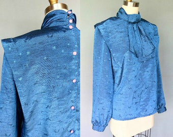 office flirt / 1980s bright blue button back blouse with jabot collar / large