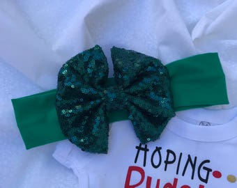 Cute Christmas Onesie and a big Green Sequins Bow attached to a Green Nylon Headband