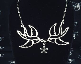 Soulmates - Pair of antique silver tattoo swallows with dainty flower charm