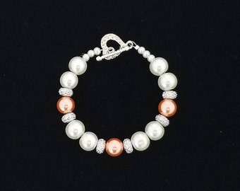 White Faux Pearl Beaded Bracelet with Orange and Rhinestone-Like Accent Beads