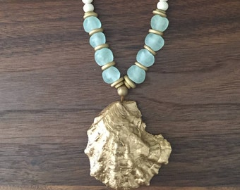Gold leaf oyster shell with white wood necklace