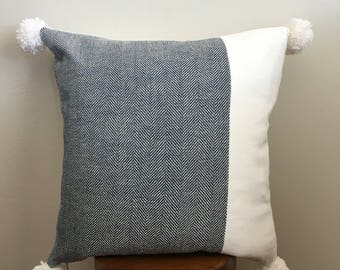 Modern blue herringbone patterned pillow cover with Pom poms