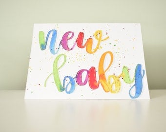 Handmade to order, hand lettered, bright new baby card.