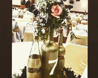 Gold Wine Bottles   striped wine bottles   repurposed wine bottles   wedding centerpieces   wine bottle centerpiece