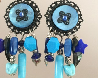 long dangle earrings in shades of blue and black