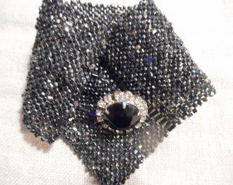 woven bracelet in unique button sewing.