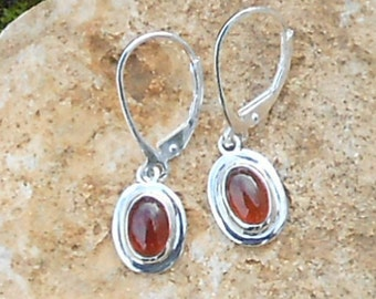 Stud earring, 925 sterling silver, hessonite Garnet size oval cabochon 7 x 5 mm