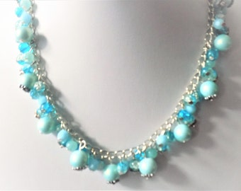 Mid-long necklace, silver and blue glass beads, flower beads.