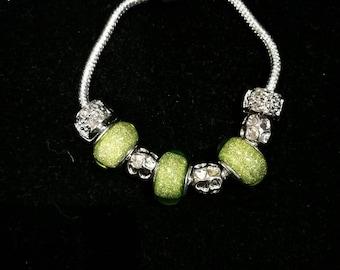European bracelet with iridescent yellow green European beads