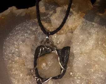 Black river stone and added quartz