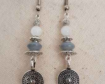Silver charm metal metal and white cat's eye bead hook earrings