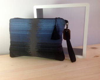 Clutch with handstrap in gradient blue black jacquard