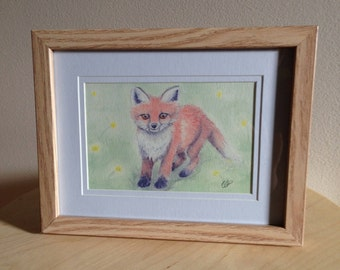 Framed watercolour painting print of a Red Fox in a meadow of yellow flowers