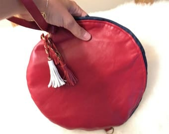 round red leather bag