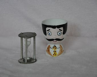 Kitschy little man egg holder and 3 minute egg timer