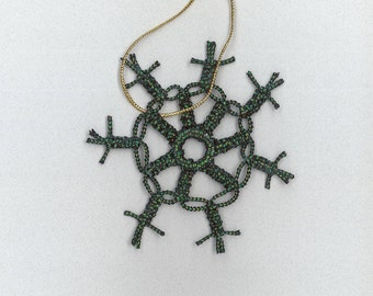 Handmade black with green sparkly craft cord macrame snowflake by TwistedandKnottyUS
