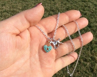 """Light blue heart lock and horse charm necklace on 18"""" cable chain."""
