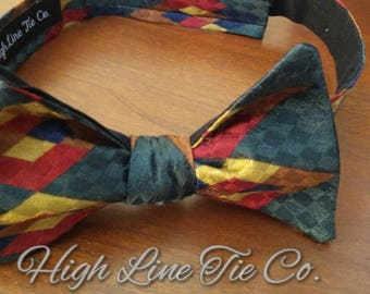 Green, Red and Gold Self-tie bow tie.