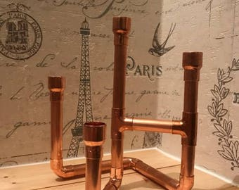 Four candle copper candelabra