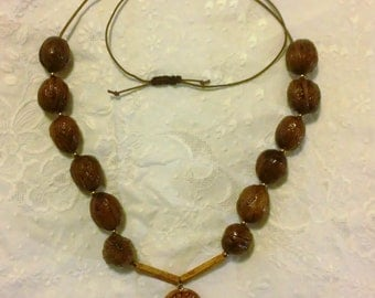 Natural necklace, walnuts, wood