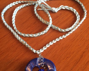 Can be worn as a pendant or multi wrap bracelet.